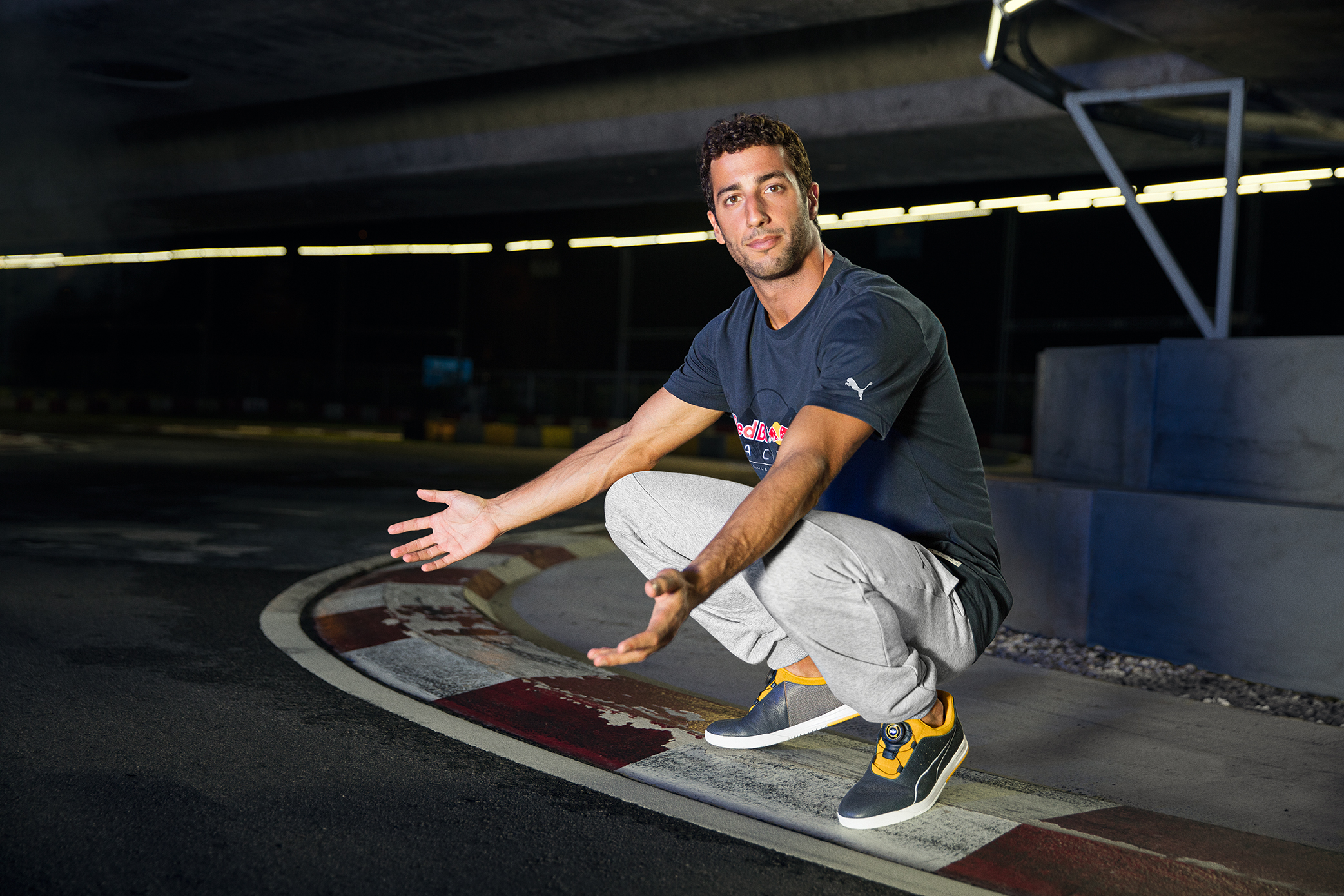 Red Bull Racing driver Daniel Ricciardo wears the PUMA Red Bull Racing DISC.jpg
